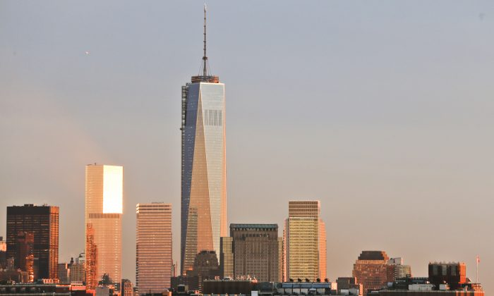 Sunlight shines on the World Trade Center New York City skyline Tuesday, Oct. 8, 2013, in New York. (AP Photo/Frank Franklin II)