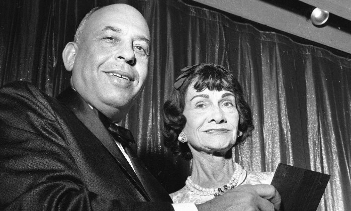 "Fashion designer Gabrielle ""Coco"" Chanel, right, receives the Neiman-Marcus fashion award for 1958 from Stanley Marcus, president of Neiman-Marcus Co., in Dallas, Texas, Sept. 9, 1957.   The celebration marks the 50th anniversary of the Dallas specialty store.  (AP Photo)"