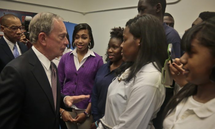 New York's Mayor Michael Bloomberg (2nd L) and Schools Chancellor Dennis Walcott (far L) meet with senior students, after holding press conference at the Bedford Academy High School, New York, on Dec. 3, 2013. (Bebeto Matthews/AP)