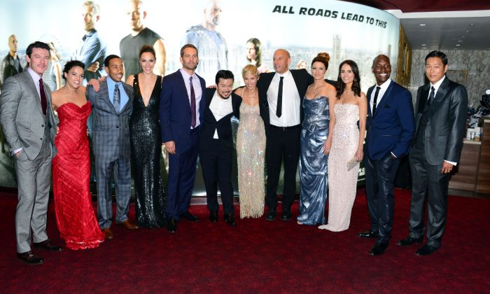 From left, Luke Evans, Michelle Rodriguez, Ludacris, Gal Gadot, Paul Walker, Justin Lin, Elsa Pataky, Vin Diesel, Gina Carano, Jordana Brewster, Tyrese Gibson, Sung Kang pose for photographers at the World Premiere of Fast & Furious 6 in London on Tuesday, May 7, 2013. (Jon Furniss/Invision/AP)