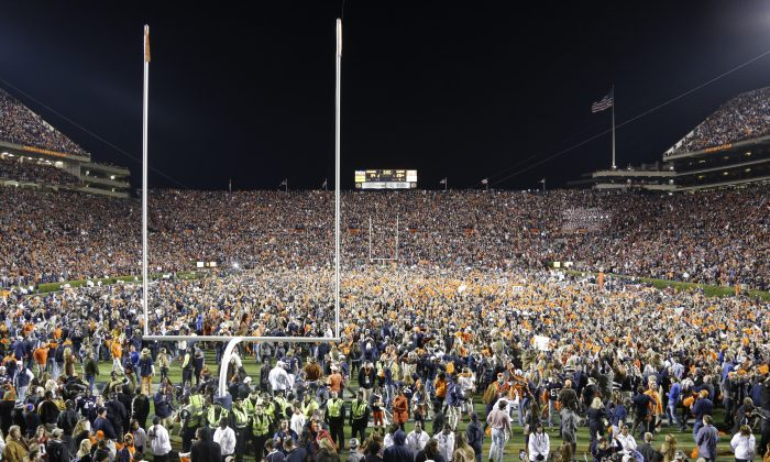 Auburn fans react at the end of a win over Alabama in Auburn, Ala., Saturday, Nov. 30, 2013. Auburn beat Alabama 34-28.  (AP Photo/Jay Sailors)