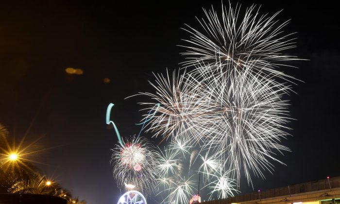 Fireworks light up the sky as Filipinos welcome the New Year Wednesday Jan. 1, 2014 in Manila, Philippines. (AP Photo/Bullit Marquez)