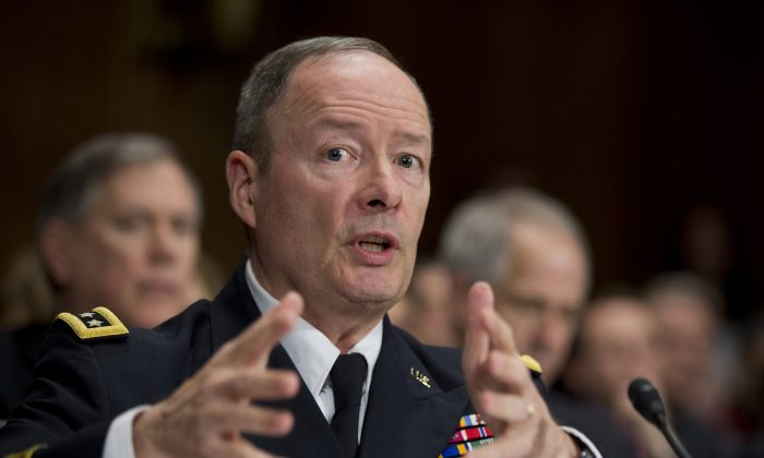 National Security Agency Director Gen. Keith Alexander testifies on Capitol Hill in Washington on Dec. 11. A White House task force recommends new limits on surveillance. (Manuel Balce Ceneta/AP)