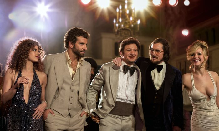 "(L-R) Amy Adams, Bradley Cooper, Jeremy Renner, Christian Bale and Jennifer Lawrence in a scene from ""American Hustle."" (AP Photo/Sony - Columbia Pictures, Francois Duhamel)"