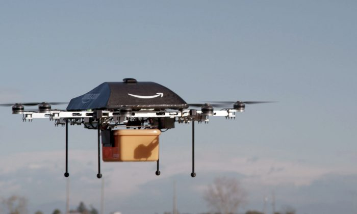 Amazon's Prime Air unmanned aircraft could deliver Amazon.com products anywhere at any time in 30 minutes or less. German DHL is testing the use of drones for package deliver as well, it was reported on Dec. 9, 2013. (AP Photo/Amazon)