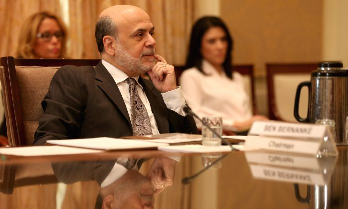Federal Reserve Board Chairman Ben Bernanke participates in a meeting of the Board of Governors at the Federal Reserve in Washington, Oct. 24. (Mark Wilson/Getty Images)