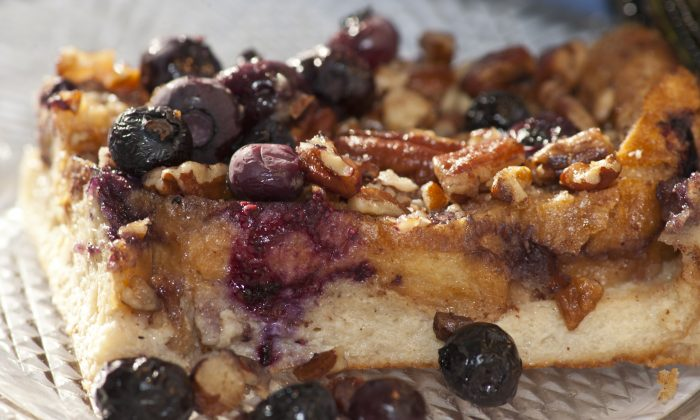 This southern-style baked French toast is topped with butter, sugar, pecans and blueberries.(Cat Rooney/Epoch Times)