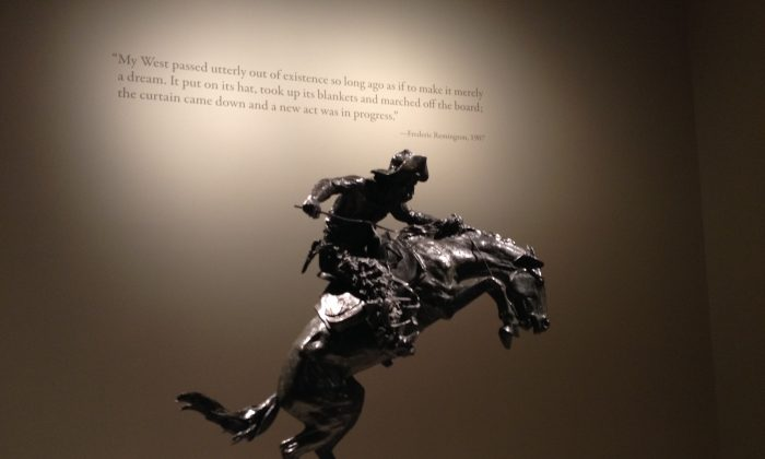 "A view of ""The Broncho Buster,"" 1895 (cast 1906), by Frederic Remington (1861–1909) at the Metropolitan Museum's exhibit, ""The American West in Bronze."" (Christine Lin/ Epoch Times)"