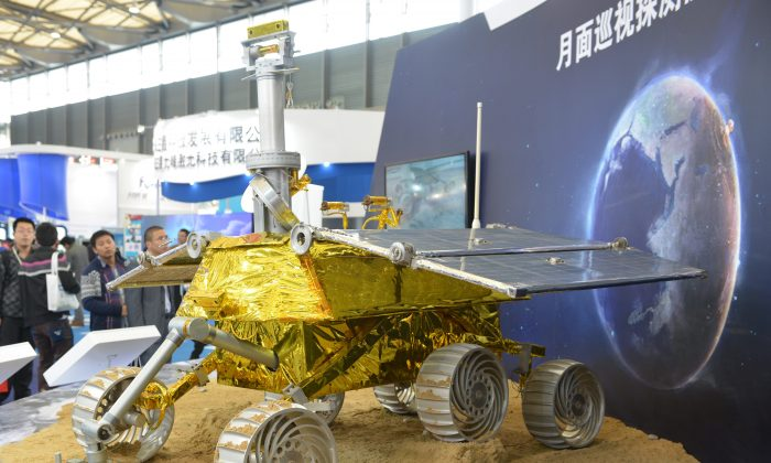 A nuclear explosion is shown on the earth in an exhibit for China's lunar rover, at the China International Industry Fair 2013 in Shanghai on November 5. (PETER PARKS/AFP/Getty Images)