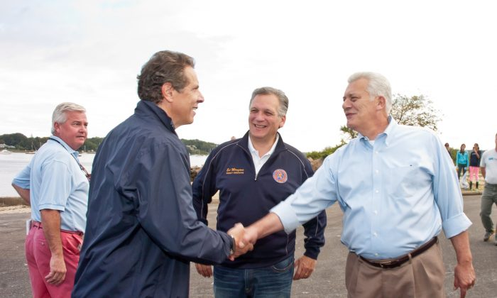 New York Gov. Mario Cuomo, Nassau County Executive Ed Mangano, and Oyster Bay Town Supervisor John Venditto attend Friends Of The Bay Cleanup at Theodore Roosevelt Park in Oyster Bay, N.Y. on Sept. 21, 2013. (Steven Henry/Getty Images)