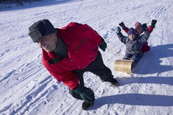 During the winter months, don't just stay indoors and sip hot chocolate, get outside and get fit with the whole family. (Photos.com)