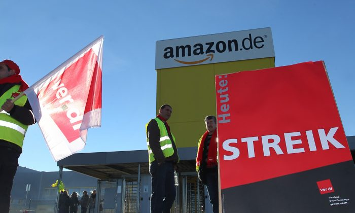 Amazon employees demonstrate during a strike in front of an Amazon logistics center, in Graben, Germany, Dec. 16, 2013. (AP Photo/dpa, Karl-Josef Hildenbrand)