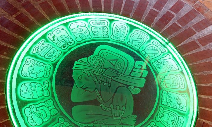 Set in the floor of Casa del Jade in Antigua is this Mayan calendar. Appropriately lighted with green. (Myriam Moran copyright 2013)