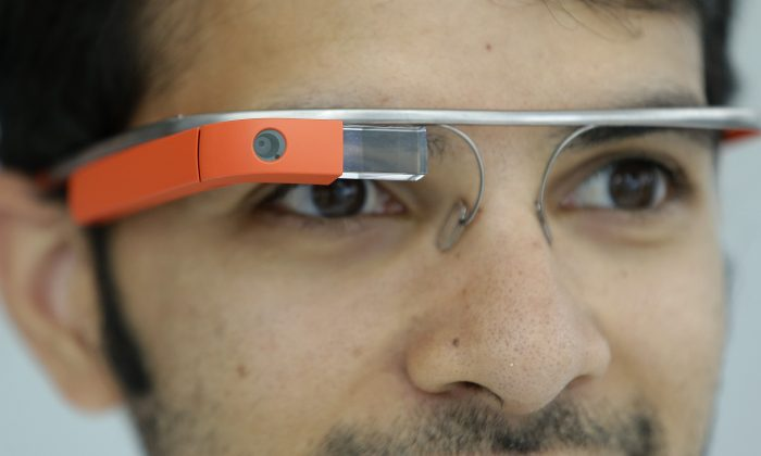 Google Glass team member Salil Pandit wears Google Glasses at a booth at Google I/O 2013 in San Francisco, Wednesday, May 15, 2013. (AP Photo/Jeff Chiu)