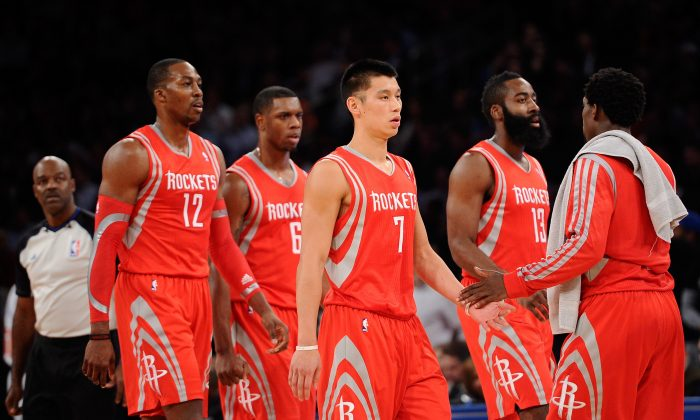 Jeremy Lin #7 of the Houston Rockets walks off the court with teammates Dwight Howard #12, Terrence Jones #6 and James Harden #13 during a timeout at Madison Square Garden on November 14, 2013 in New York City. The Rockets defeat the Knicks 109-106. (Maddie Meyer/Getty Images)