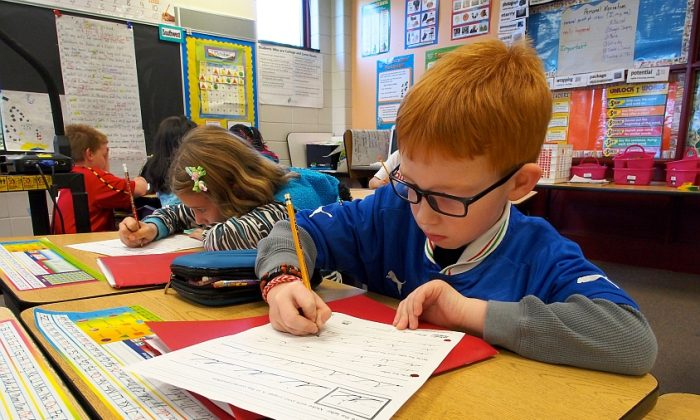 Third graders practice handwriting at Triadelphia Ridge Elementary School in Ellicott City, Maryland on Oct. 15, 2013. (Robert MacPherson/AFP/Getty Images)