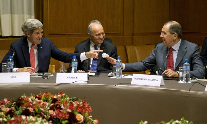 U.S. Secretary of State John Kerry (L), French Foreign Minister Laurent Fabius, and Russia's Foreign Minister Sergei Lavrov gather at the United Nations Palais, Nov. 24, 2013, in Geneva, Switzerland, during the Iran nuclear talks. (Carolyn Kaster/AP)
