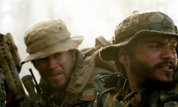 "(L–R) Marcus Luttrell (Mark Wahlberg) and Danny Dietz (Emile Hirsch) in ""Lone Survivor,"" the true story of four Navy SEALs on a covert mission to neutralize a high-level Taliban operative in the mountains of Afghanistan. (Courtesy of Universal Pictures)"