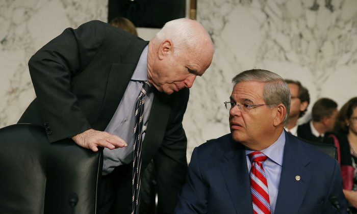 U.S. Sen. John McCain (R-AZ) (L) talks with Chairman Robert Menendez (D-NJ) before the Senate Foreign Relations Committee vote on Capitol Hill in Washington, D.C., Sept. 4, 2013. (Mark Wilson/Getty Images)