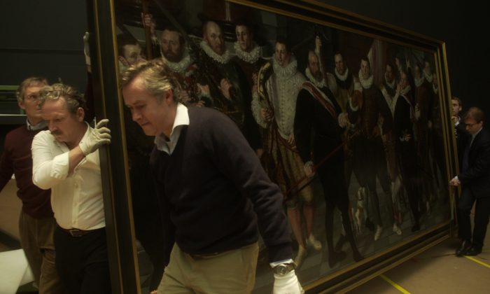 Rijksmuseum staff carry a painting in the documentary 'The New Rijksmuseum' directed by Oeke Hoogendijk. (Courtesy of Peter van Huystee/Column Film)