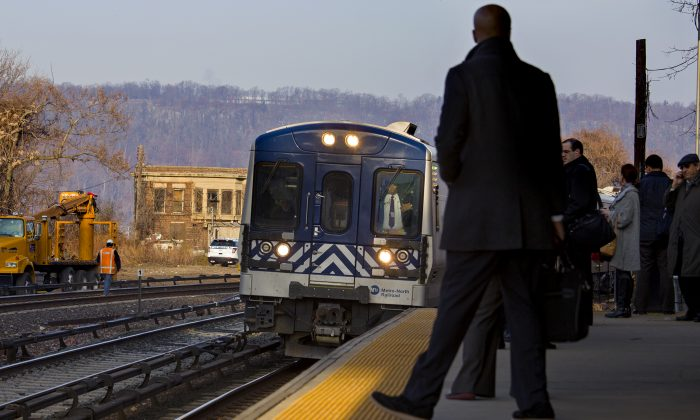 A Metro-North passenger train pulls into the Spuyten Duyvil station in the Bronx, New York on Dec. 4, 2013. (Craig Ruttle/AP)