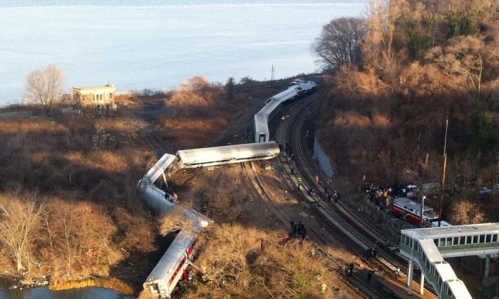 Cars from a Metro-North passenger train are scattered after the train derailed in the Bronx, New York, on Dec. 1, 2013. Four people were killed and 63 injured. (AP Photo/Edwin Valero)