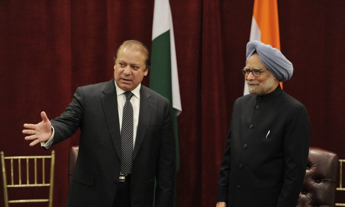 Pakistani Prime Minister Nawaz Sharif (L) introduces his delegation to his Indian counterpart Manmohan Singh during a meeting on the sidelines of the 68th Session of the United Nations General Assembly on September 29, 2013, at the New York Palace Hotel in New York. Both the Prime Minister, since Tuesday, have engaged in war of words over Kashmir issue, with Sharif expressing a dream of seeing Kashmir free from Indian occupation in his life-time. (Stan Honda/AFP/Getty Images)