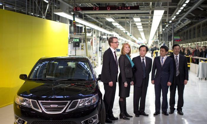 From left: Nevs MD, Mattias Bergman, Swedish Minister of Trade, Annie Loof, China's Ambassador to Stockholm, Chen Yuming, vice mayor of Xingdao Li Chenggang and State Power Group CEO Kai Johan Jiang stand next to the first production Nevs (National Electric Vehicle Sweden) Saab 9-3 Aero at the Trollhattan factory in Sweden, Monday, Dec. 2, 2013. (AP Photo/TT, Bjorn Larsson Rosvall)