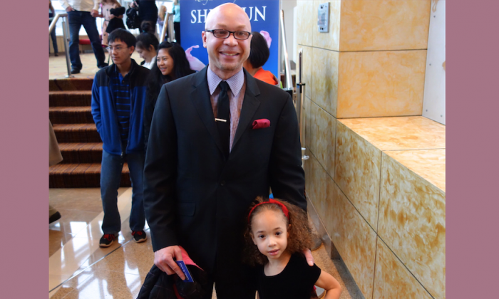 Mr. Robert Easterling brought his little daughter to see the matinee of Shen Yun Performing Arts, at the Cobb Energy Performing Arts Centre, on Dec. 28. (Mary Silver/Epoch Times)
