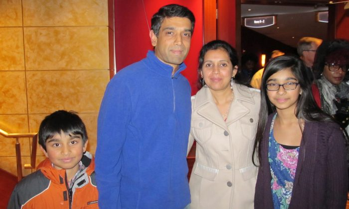 Chandra Sekar and his family enjoy an evening at Shen Yun Performing Arts at the Cobb Energy Centre in Atlanta, Dec. 27. (Roland Ree/Epoch Times)