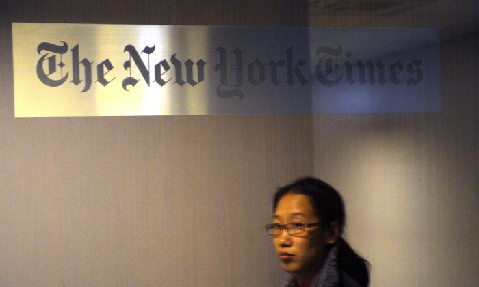 A woman walks past the New York Times office in Shanghai on Oct. 30, 2012, not long after the Times published an article about the wealth of the family of Chinese Premier Wen Jiabao. (Peter Parks/AFP/Getty Images)