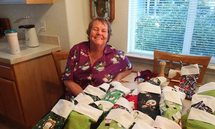 Larraine O'Carra displays stockings she made for a special needs class at a southern California high school. O'Carra's friends stuffed the stockings with gifts. (Photo courtesy of Raymond Seda)