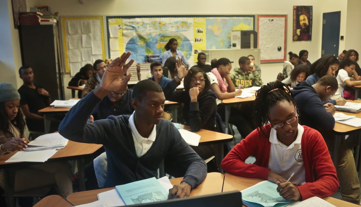 Students raise hands during a Global Studies class of 10th- and 11th-graders at Bedford Academy High School in New York on Dec. 3. Mayor Michael Bloomberg and Schools Chancellor Dennis Walcott at a press announced a record-high Advance Placement and SAT exam scores for students citywide. (Bebeto Matthews/AP)