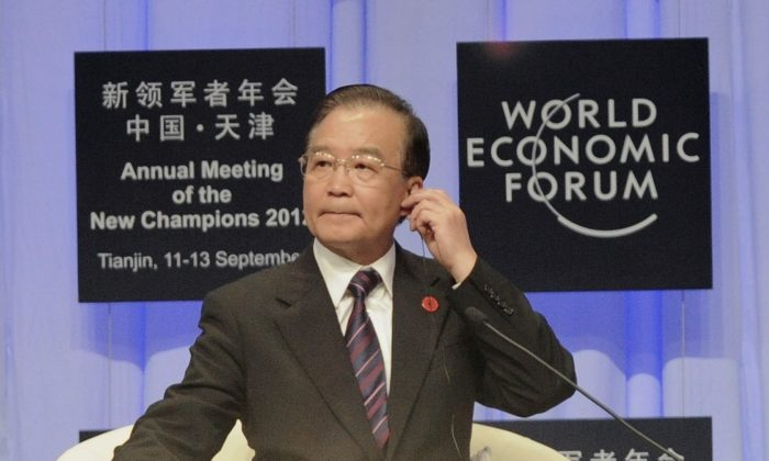 Then Chinese Premier Wen Jiabao prepares to deliver his keynote address at the World Economic Forum in Tianjin, Sept. 11, 2012. (Goh Chai Hin/AFP/Getty Images)