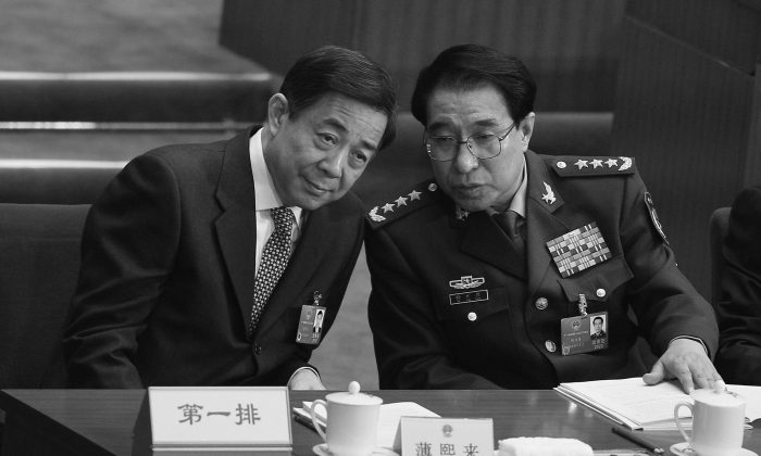 Xu Caihou (R), vice chairman of the Central Military Commission talks with disgraced CCP official Bo Xilai, during the opening ceremony of the National People's Congress (NPC) at the Great Hall of the People on March 5, 2012 in Beijing, China. Xu Caihou is under investigation due to his partnership with former Politburo Standing Committee member Zhou Yongkang, according to a high-level official in Beijing. (Feng Li/Getty Images)