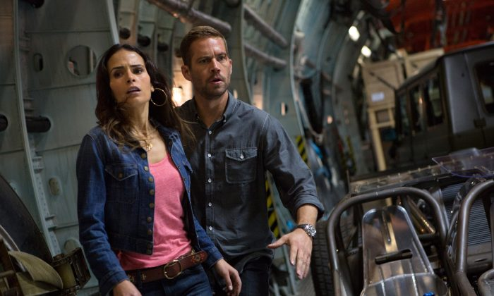 "Jordana Brewster (Mia Toretto), left, and Paul Walker (Brian O'Conner) in a scene from ""Fast & Furious 6."" (AP Photo/Universal Pictures, Giles Keyte)"