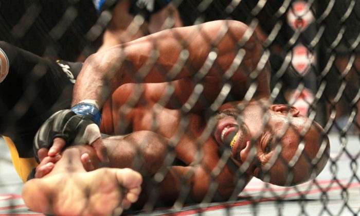 Anderson Silva, of Brazil, screams after kicking Chris Weidman of Baldwin, N.Y., and injuring his leg during the UFC 168 mixed martial arts middleweight championship bout on Saturday, Dec. 28, 2013, in Las Vegas. Weidman won during the second round by a technical knock out after the kick by Silva. (AP Photo/The Las Vegas Sun, Sam Morris)