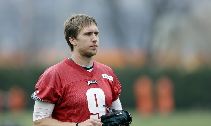 Philadelphia Eagles quarterback Nick Foles walks to a news conference after practice at the NFL football team's training facility, Thursday, Dec. 5, 2013, in Philadelphia. (AP Photo/Matt Rourke)