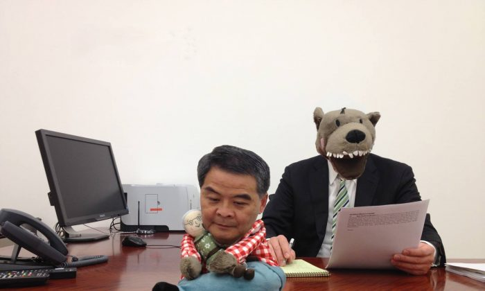 Hong Kong Chief Executive Leung Chun-ying with Lufsig, the stuffed wolf from Little Red Riding Hood who inspired Leung's new nickname. Leung cheerfully placed the wolf on his desk and put the photo on his blog, but netizens soon came up with their own version. (Internet photo)