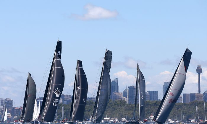 Some of the bigger boats lead the field in Sydney Harbour just after the start of the Sydney Hobart yacht race Thursday, Dec. 26, 2013. Race officials are warning the fleet to expect gale-force winds and waves of up to 12 meters (40 feet) during the race that covers 628 nautical miles, or 1,163 kilometers (723 miles). (AP Photo/Rick Rycroft)
