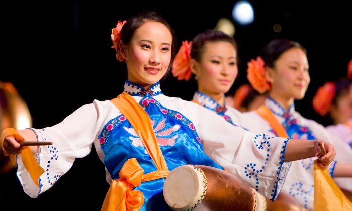 Dancers play the waist drum in a Shen Yun performance. Shen Yun Performing Arts was established with a mission to revive the true traditional culture of China that has a history of 5,000 years. Much of this culture has been destroyed over the past 60-plus years under communist rule, especially during campaigns such as the Cultural Revolution. (Photo courtesy of Shen Yun Performing Arts)