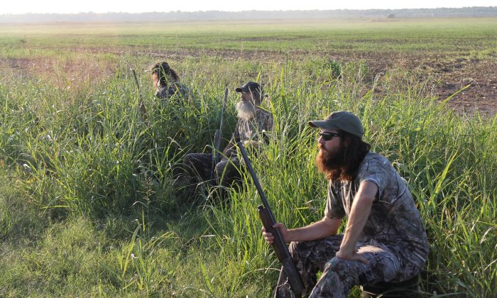 """From left, Phil Robertson, Si Robertson, and Jase Robertson in """"Duck Dynasty."""" (AP Photo/A&E, Art Streiber)"""