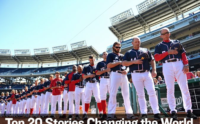Left fielder Bryce Harper 34 of the Washington Nationals and teammates have a moment of silence for the victims of the Navy Yard shooting at Nationals Park in Washington, on Sept. 17. (Patrick Smith/Getty Images)