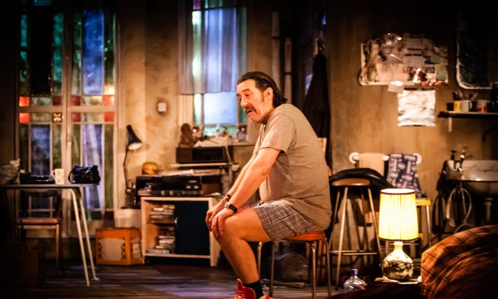 """Ciaran Hinds in an appropriately cluttered set for """"The Night Alive,"""" a new play directed and written by Conor McPherson. (Helen Warner)"""