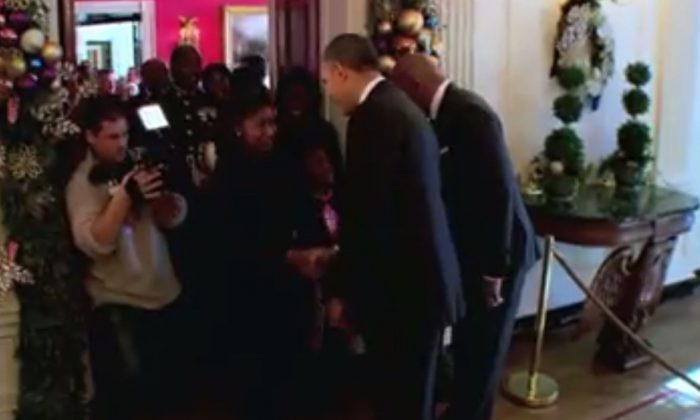 A screenshot of the interview shows President Obama and Steve Harvey at the White House.