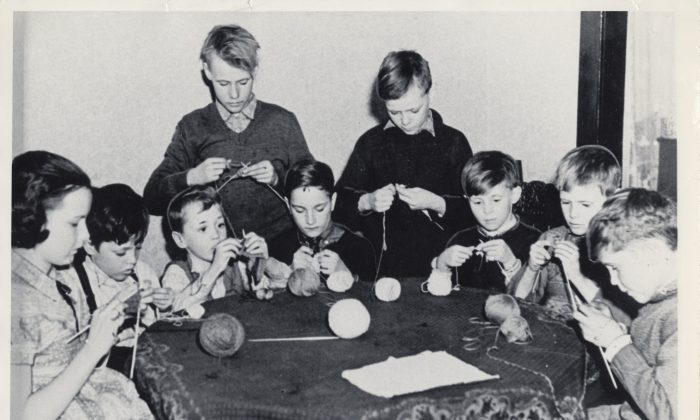 These boys and girls helped knit millions of socks and other garments for Canadian service personnel. Voluntary organizations like the Canadian Red Cross and the Navy League of Canada distributed them and other comforts overseas. (Canadian War Museum)