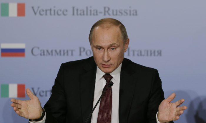 Russian President Vladimir Putin speaks to the media during a bilateral meeting between Italy and Russia on Nov. 26, 2013. Putin directed the Russian military to put special emphasis on the Arctic after Canada made a claim on the North Pole. (AP Photo/Luca Bruno)
