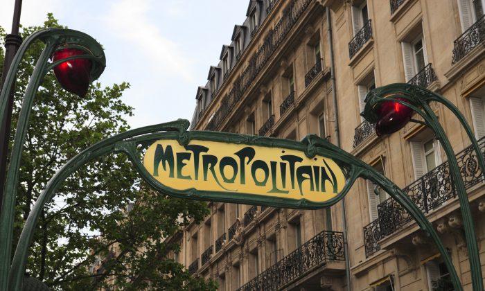 Art Deco metro sign in Paris, France. (*Shutterstock)