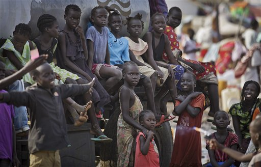 Displaced children gather on top of a truck from which the displaced were filling up containers of water, at a United Nations compound which has become home to thousands of people displaced by the recent fighting, in the capital Juba, South Sudan Sunday, Dec. 29, 2013. (AP Photo/Ben Curtis)