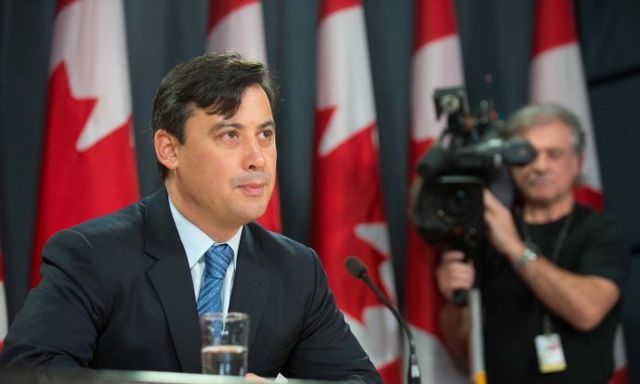 Conservative MP Michael Chong speaks to reporters about his private member's bill on Dec. 4, 2013. Chong's bill would limit the power of party leaders to selected candidates in each riding and make it simpler for MPs to replace their party leader. (Matthew Little/Epoch Times)